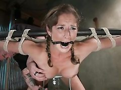 Pigtailed bondaged babe gets punished..